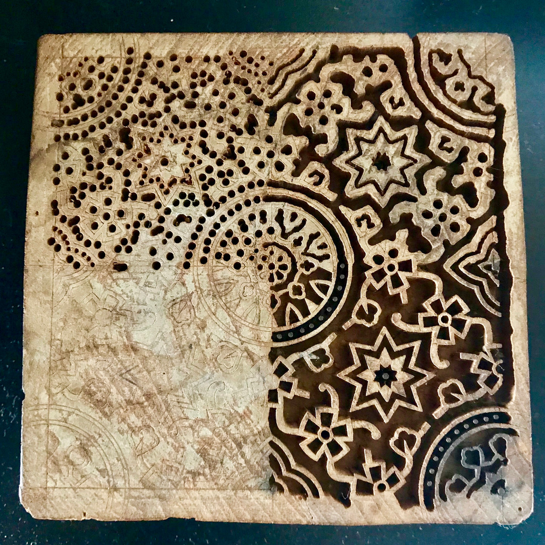 This block illustrates the different stages involved in making a printinbg block. It can take upto 3 blocks for each print. They are hand carved from acasia wood.