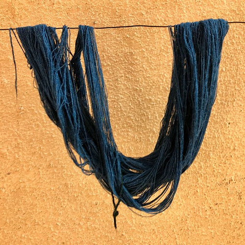 Indigo dyed fibres drying in the sun.