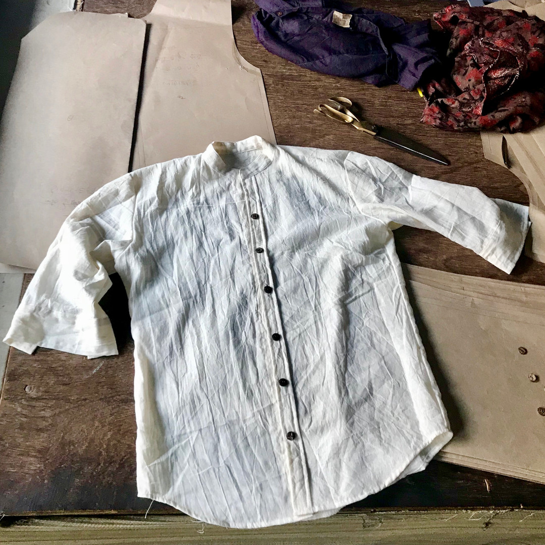 3/4 sleeve colarless shirt in pure undyed white hand produced kala cotton.  Simply finished with high quality coconut buttons.