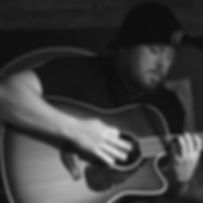 Jake Good playing guitar on stage in Collingwood, Ontario
