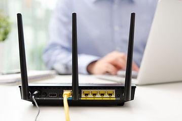 91289843_m_wifi router on desk.jpg