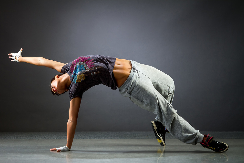 Dancer in street clothes with arched back