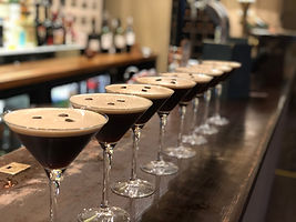 espresso martini cocktails in a long row