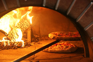 Neapolitan pizza in a wood stove.jpg