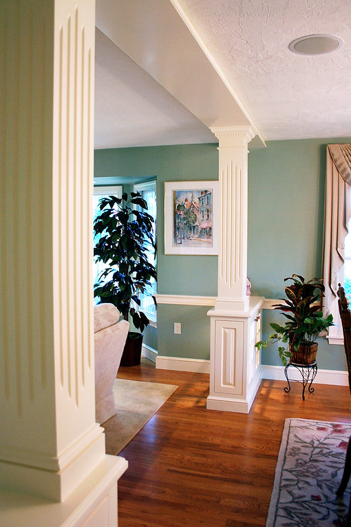 Columns with detailed millwork and paneling.  Hardwood floors,  chair rail
