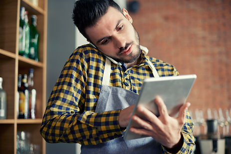 storyblocks-waiter-using-smart-phone-and