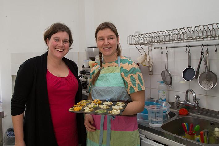 Rebs and Eva holding a tray of tarts
