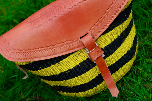 Yellow and black sisal and leather sling bag