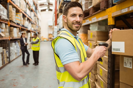 warehouse-worker-scanning-box-while-smil