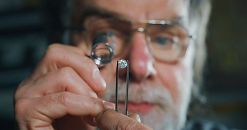 Close up of experienced goldsmith contro