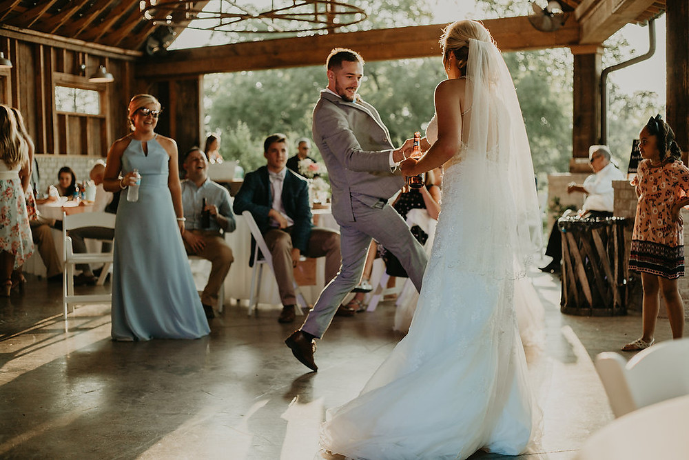 Groomsmen dancing with bride during reception