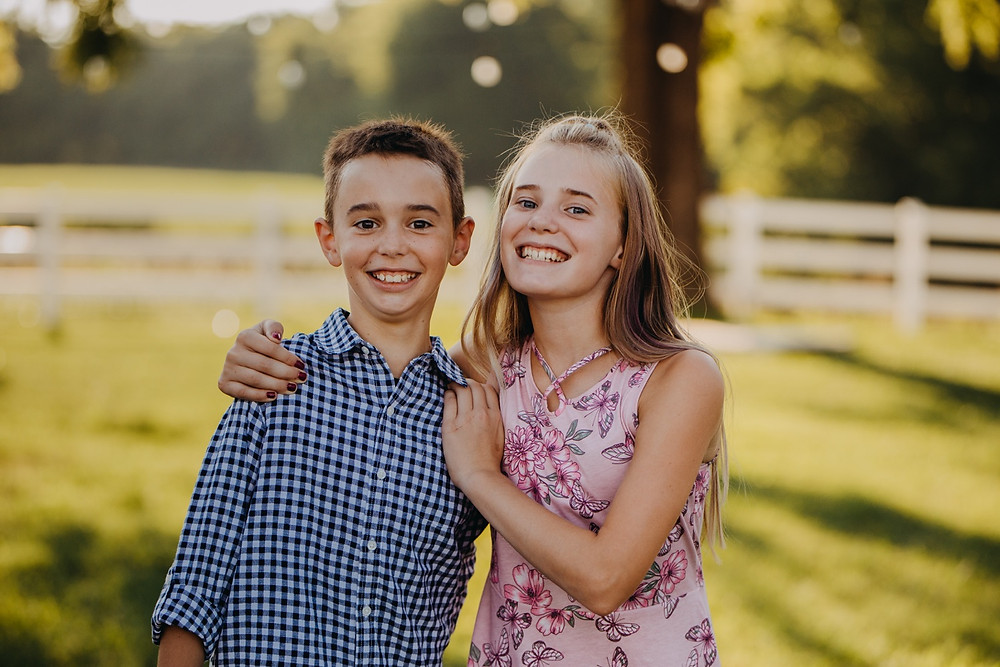 Twins smiling during family session in Knoxville and Gatlinburg, TN during golden hour