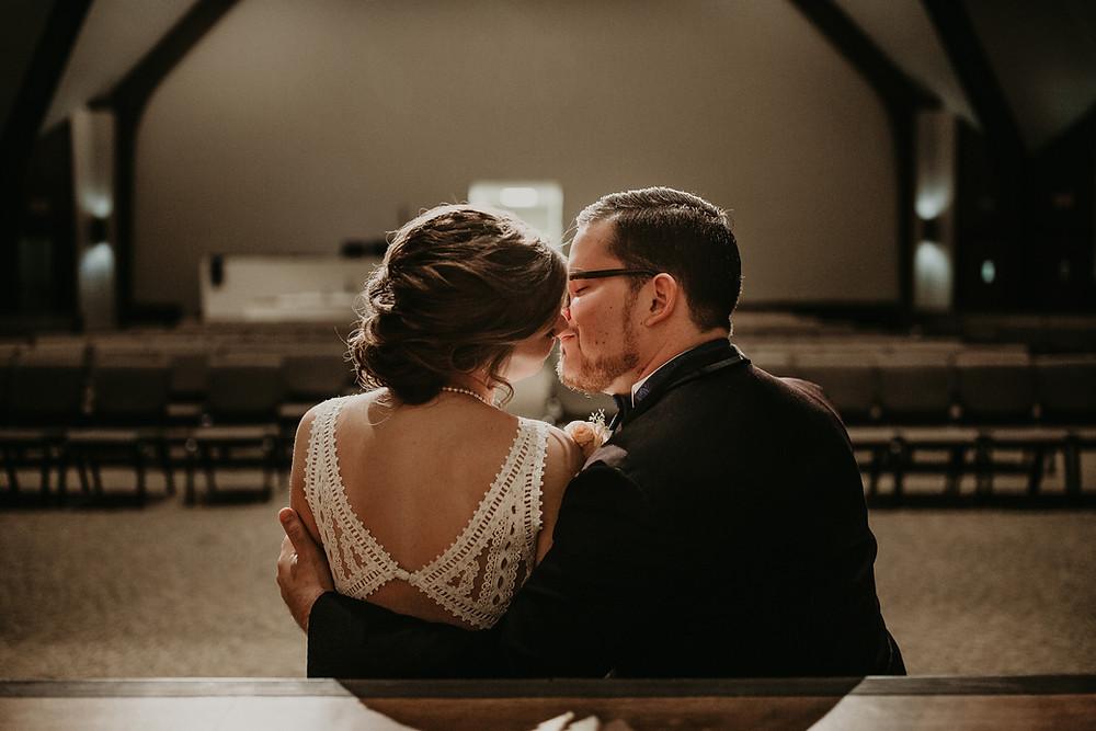 Wedding Couple in church chapel kissing