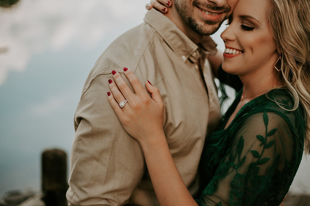 Couple holding and laughing with rings