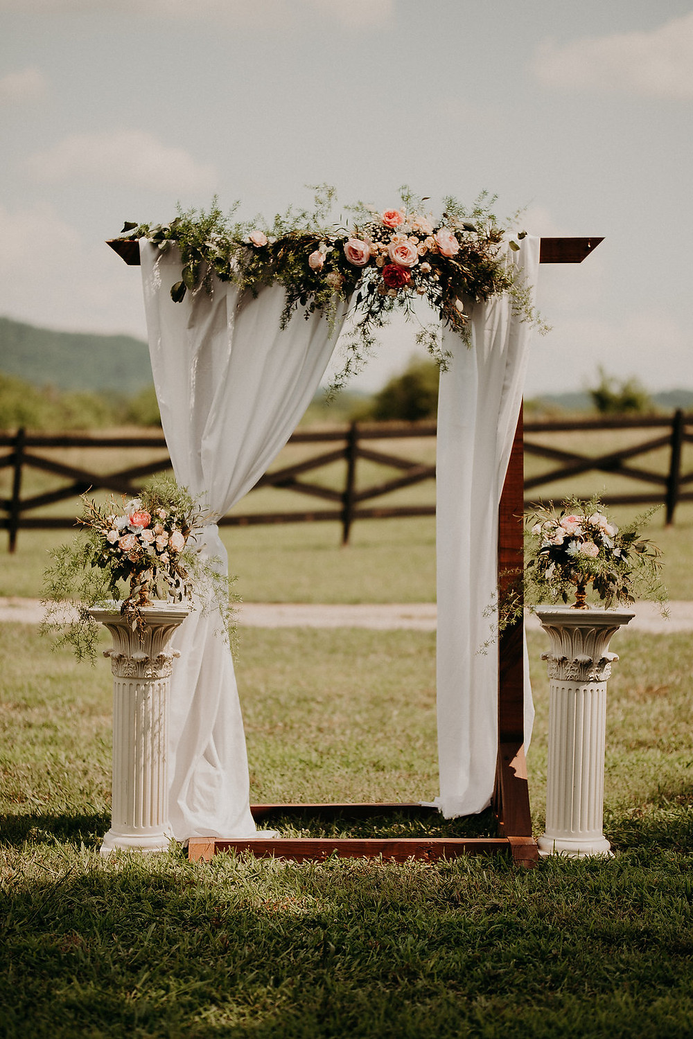 Wedding Arbor with drapery and flowers