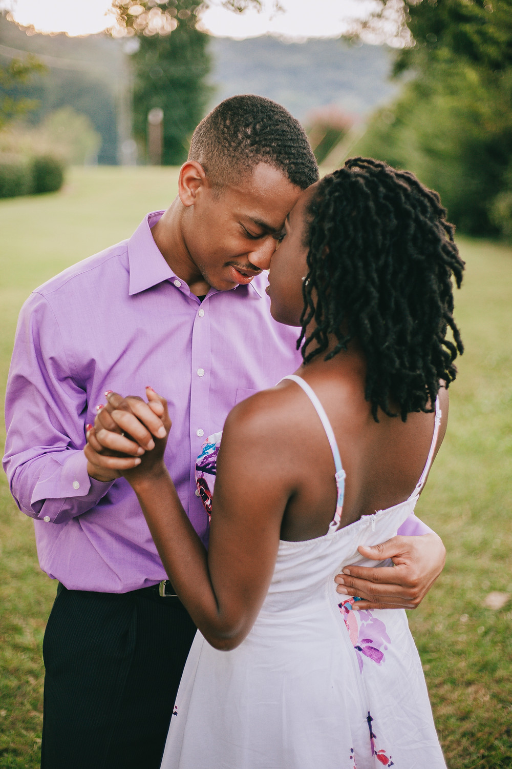 Couple slow dancing for engagement photo