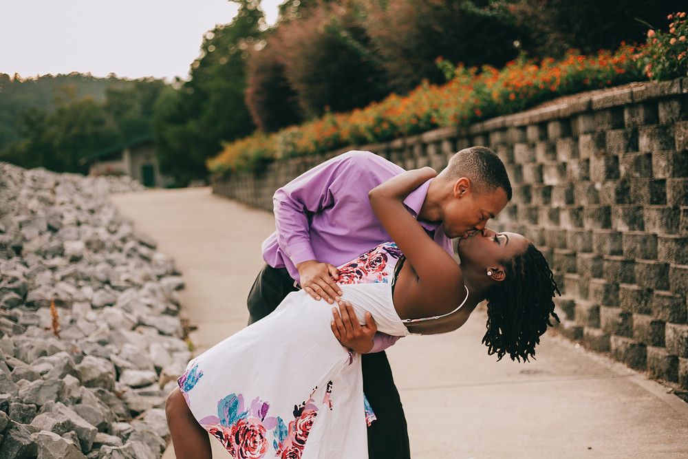 Couple dipping and kissing for an engagement picture