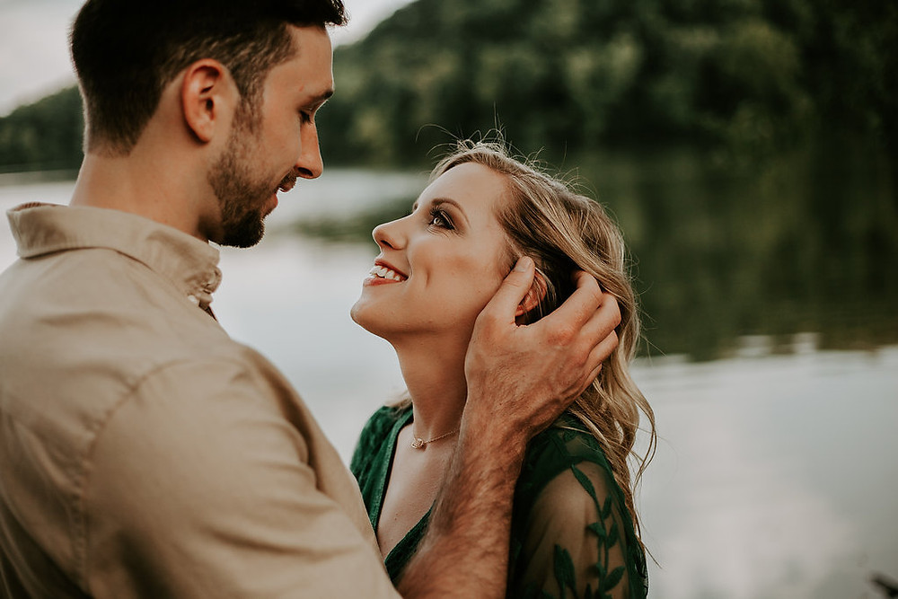 engagement session girl staring up at guy