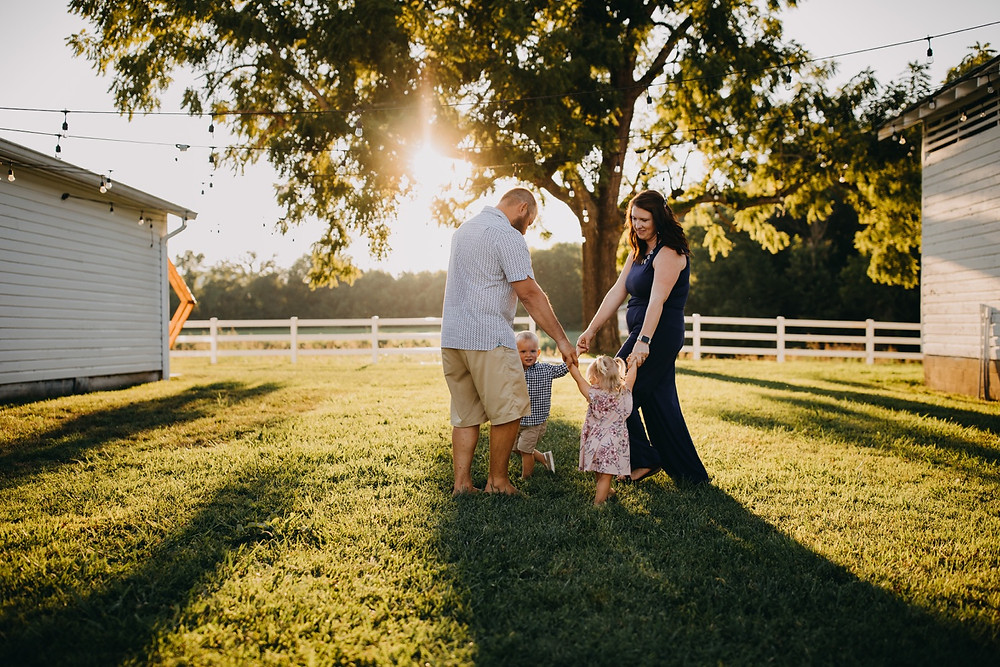 family of four playing during Family of four walking and holding hands during Family session in Knoxville and Gatlinburg, TN during golden hour