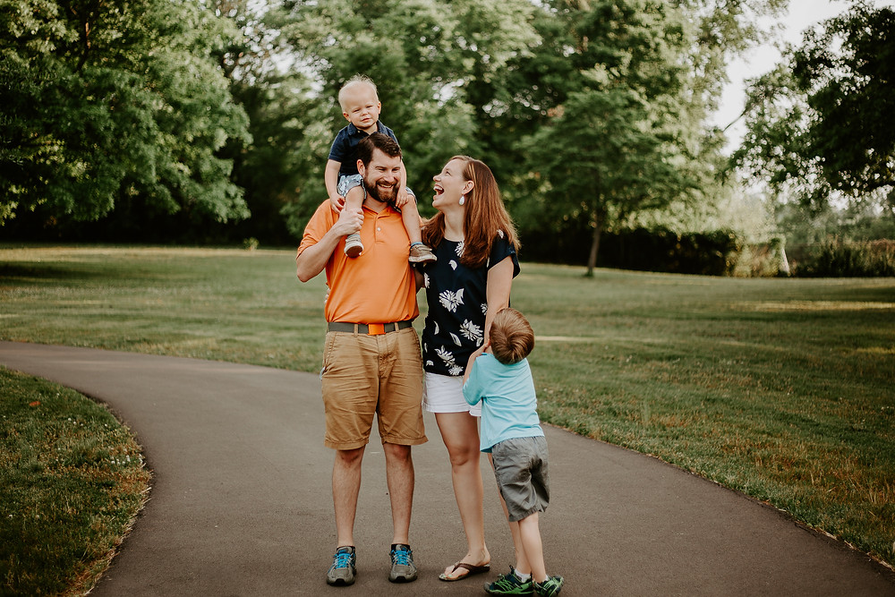 family session with kid on shoulders and laughing