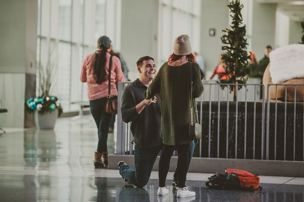 Man proposing in airport Knoxville, Tennessee