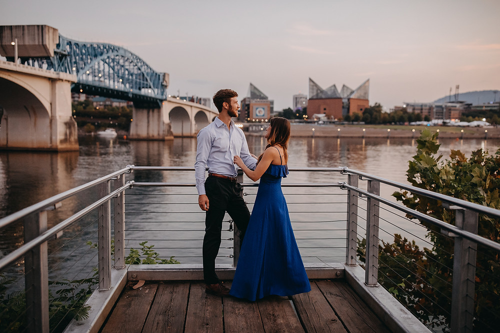 Engaged Couple on a dock at sunset