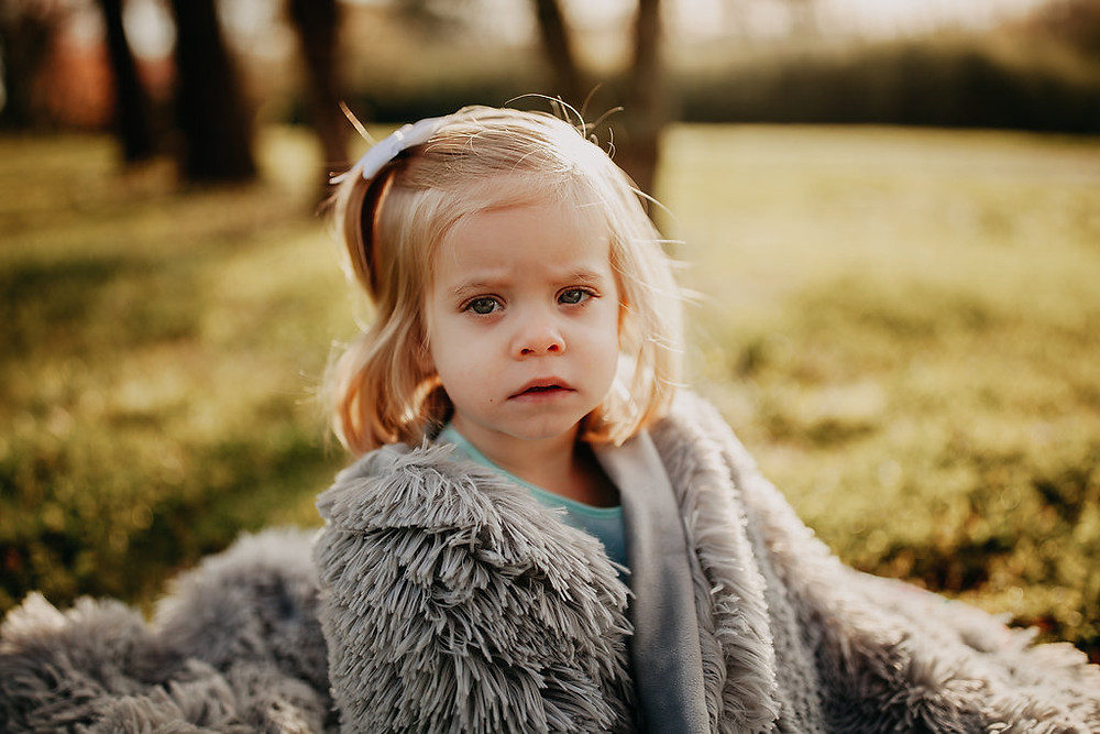 2 year old girl looking at camera