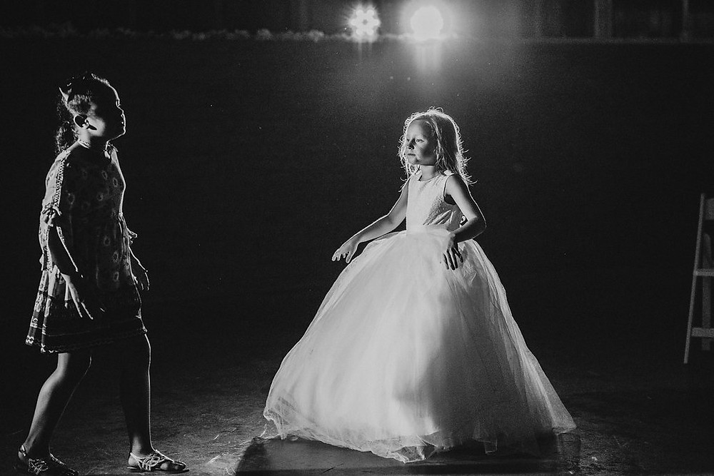 Flower girl dancing with spotlight