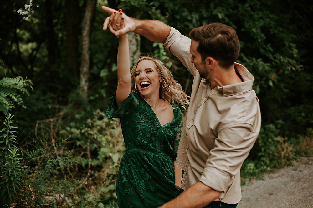 engagement session guy twirling the girl