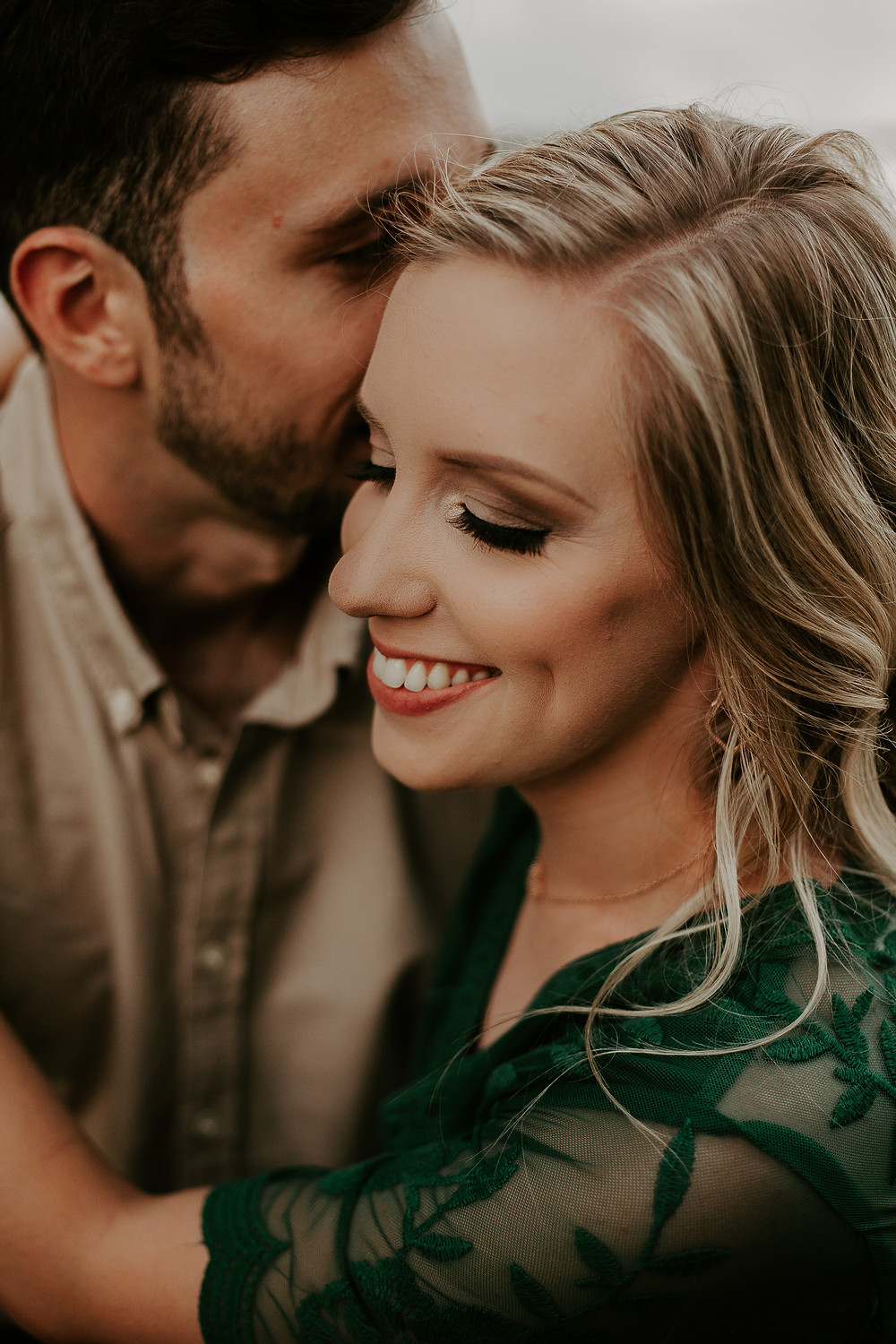 engagement session close up whispering in ear