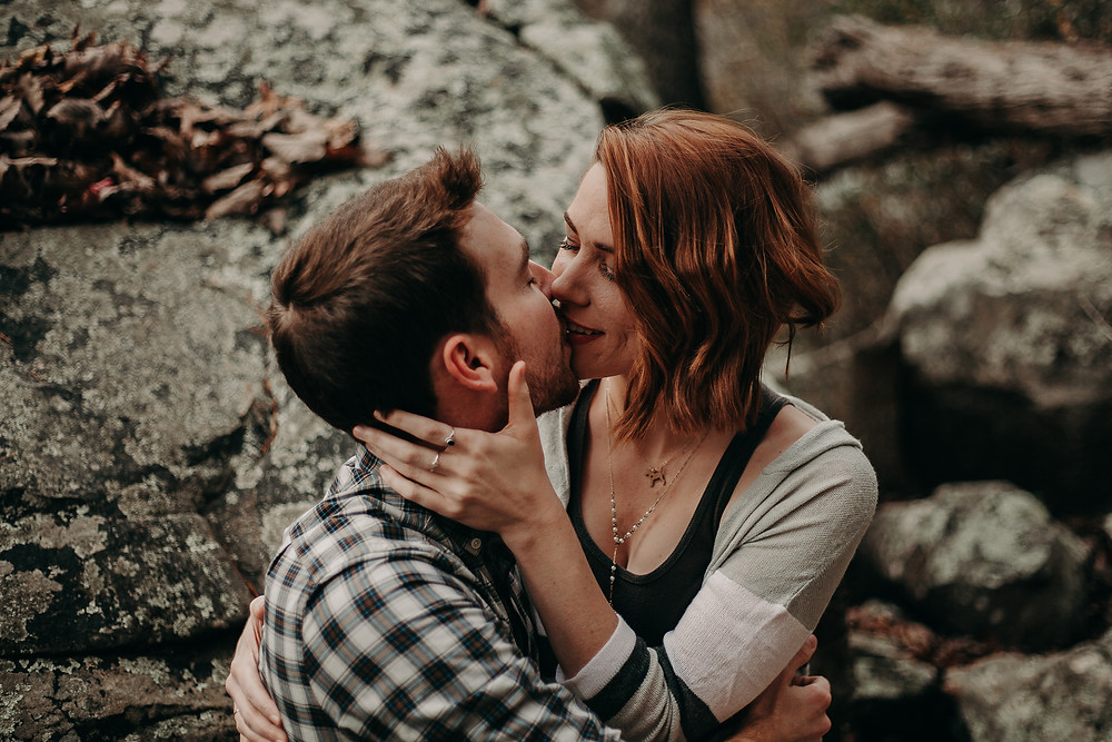 Engagement photo shoot with rocky environment