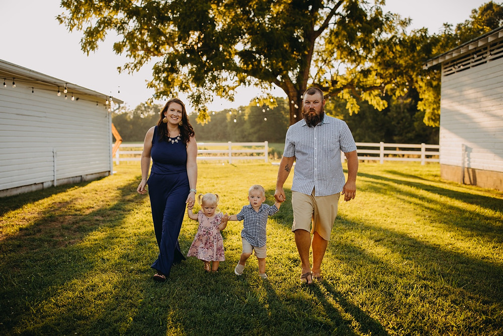 Family of four walking and holding hands during Family session in Knoxville and Gatlinburg, TN during golden hour