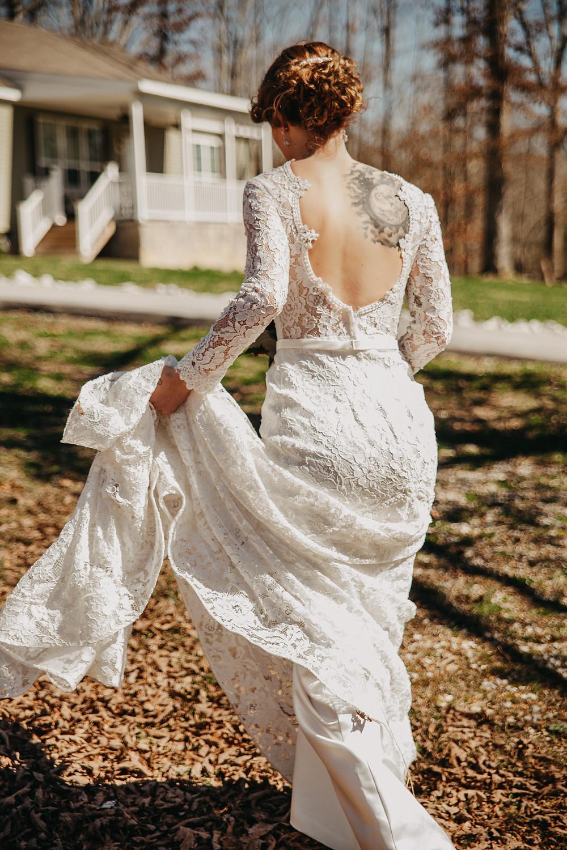 Bride in open back wedding dress walking