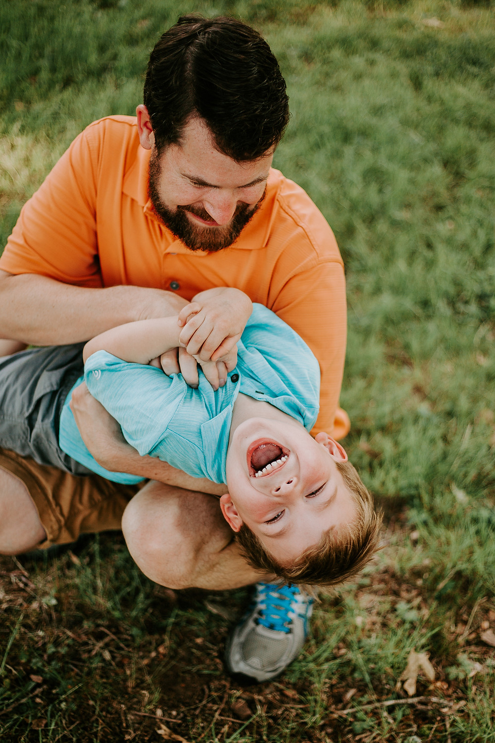 family session dad tickling child