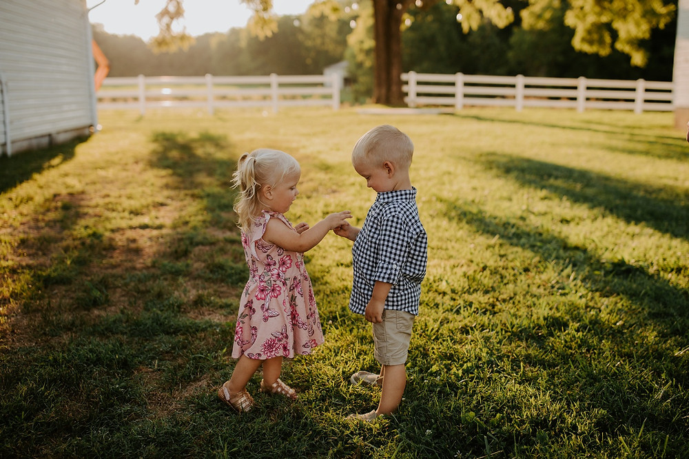 Toddler siblings playing during Family session in Knoxville and Gatlinburg, TN during golden hour