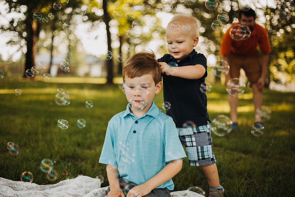 family session with kids playing with bubbles