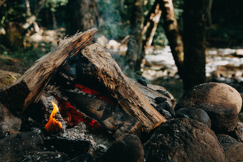 photo of a campfire with smoke