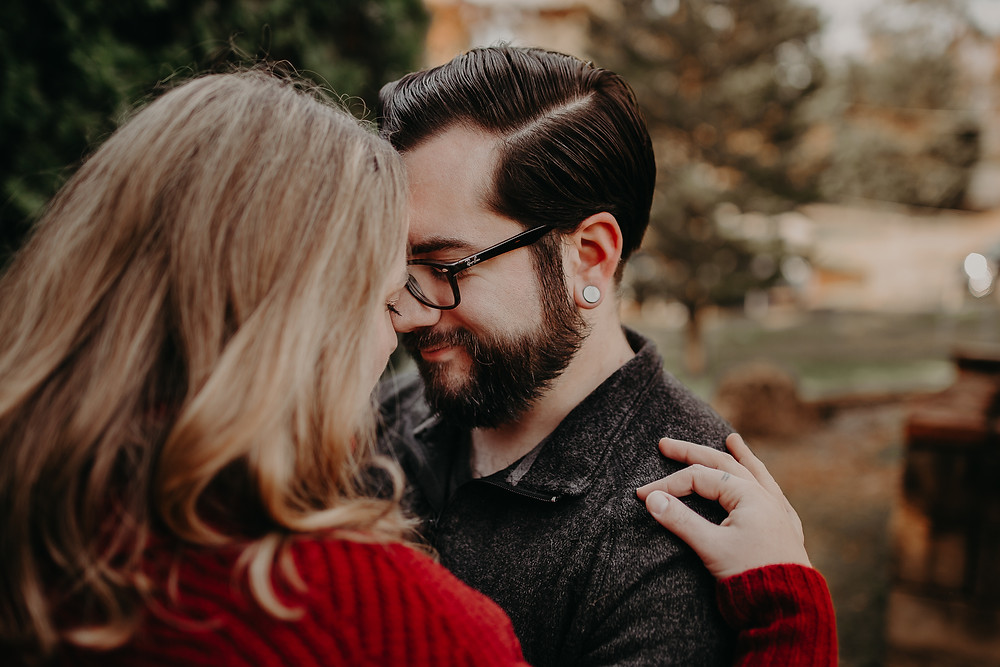 Couple touching foreheads christmas mini session
