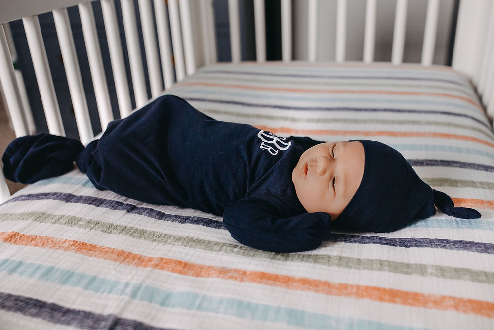 Newborn baby boy sleeping in crib