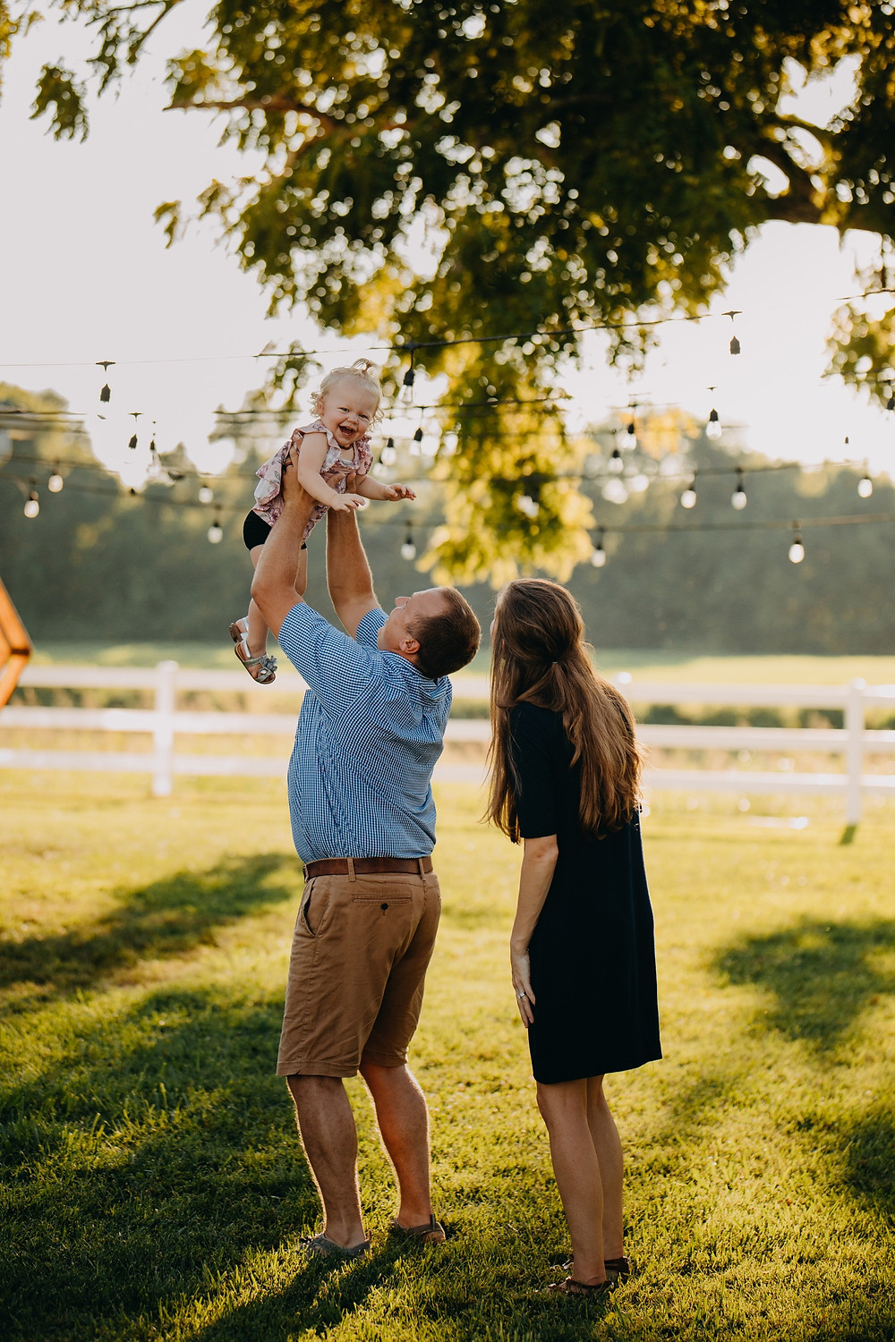 Dad playfully tossing baby daughter in air during Family session in Knoxville and Gatlinburg, TN during golden hour