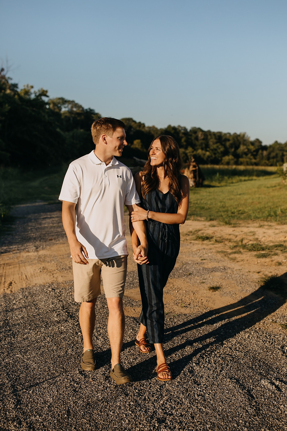 Cute romantic couple walking in sunlight during Family session in Knoxville and Gatlinburg, TN during golden hour