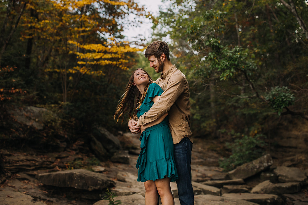 Couple snuggling in nature scenery in Chattanooga