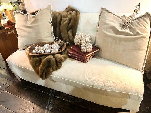 Tufted cream armless sofa