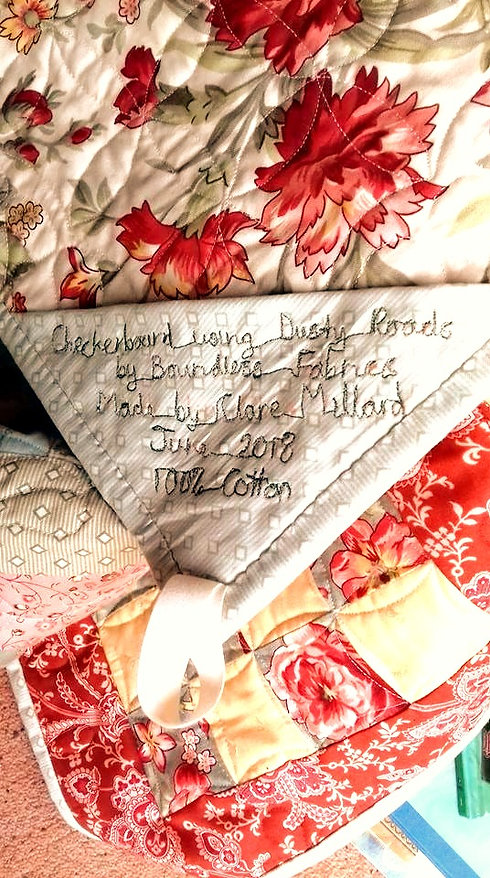 Corner label with information about the fabric, maker and date made__edited.jpg
