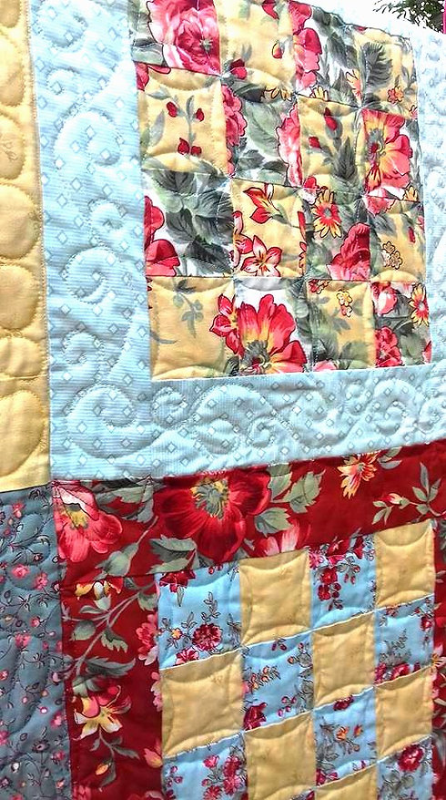 Closeup of a patchwork quilt with free motion quilting_edited.jpg