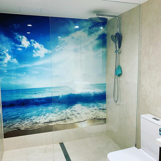 Frameless shower panel and feature glass