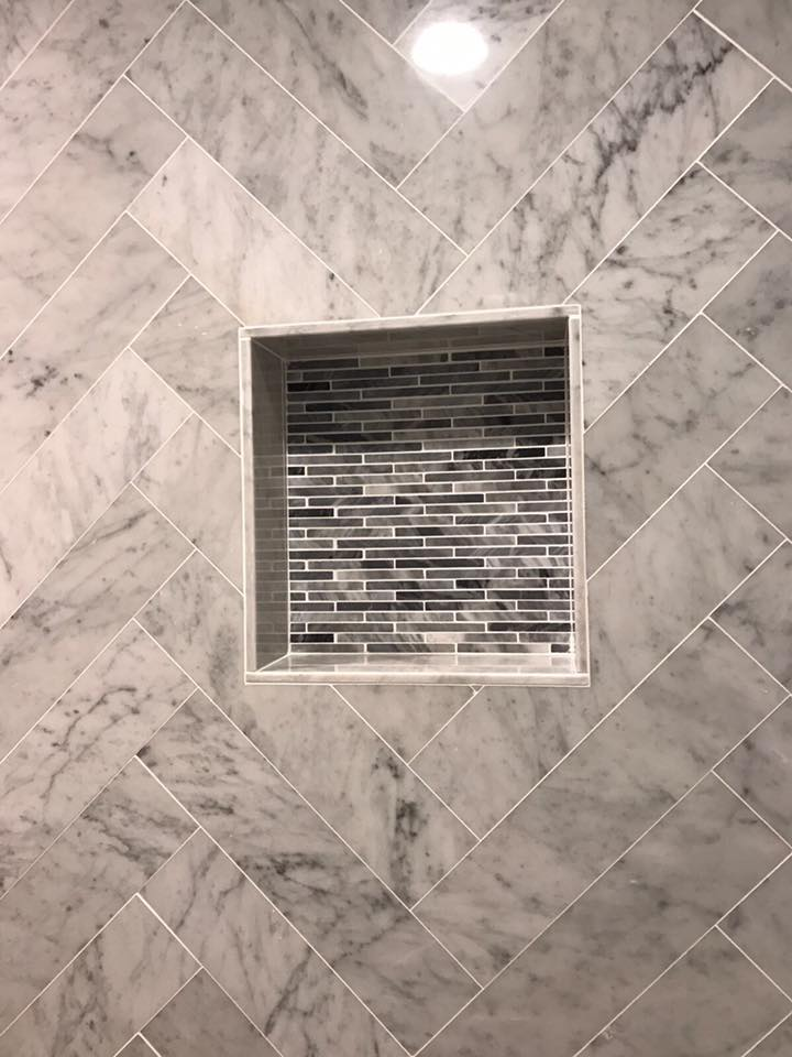 shower niche with mosaic tiles
