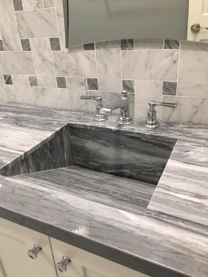 custom made sink with chrome fixtures