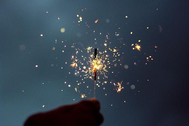 Lit Sparkler with sparks flying off it