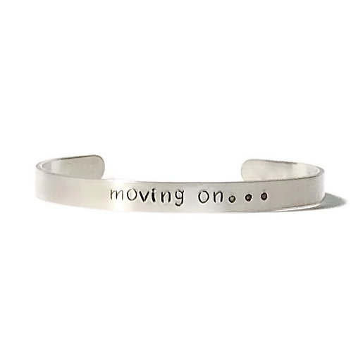 "Aluminum mantra bracelet hand stamped with ""moving on"" from Snarklets.net"